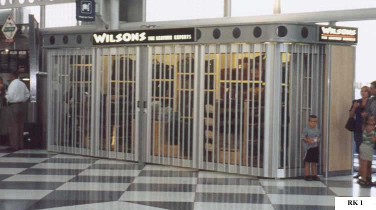 Airport retail shopping kiosk with security doors & Airport retail shopping kiosk with security doors | Merchandising ...